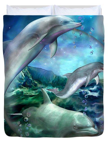 Three Dolphins Duvet Cover by Carol Cavalaris