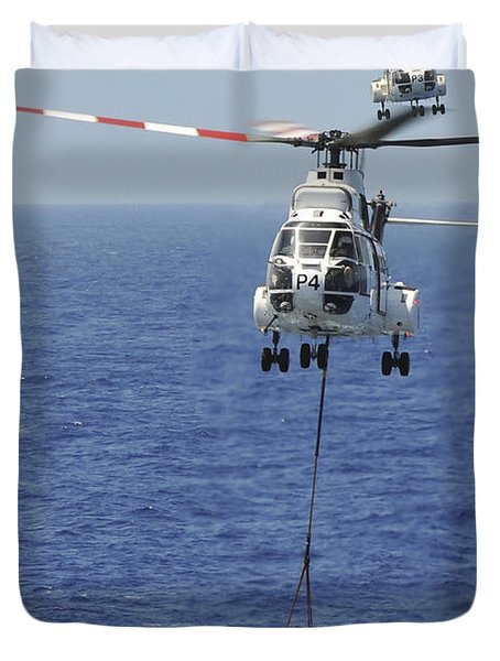 Two Sa-330 Puma Helicopters Deliver Duvet Cover by Stocktrek Images