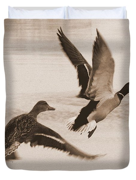 Two Winter Ducks in Flight Duvet Cover by Carol Groenen