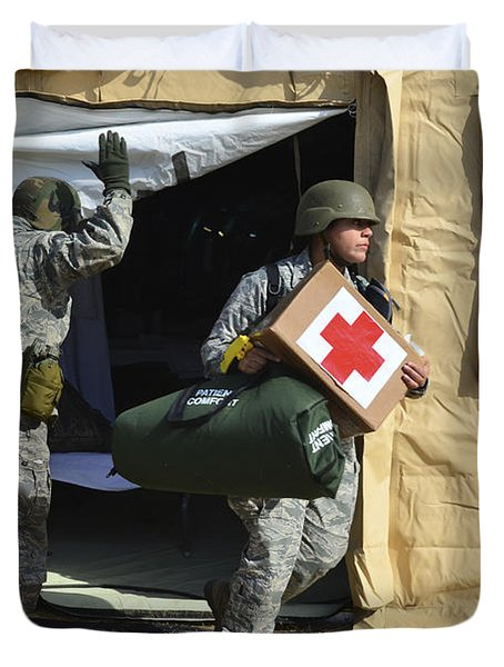U.s. Air Force Soldier Exits A Medical Duvet Cover by Stocktrek Images