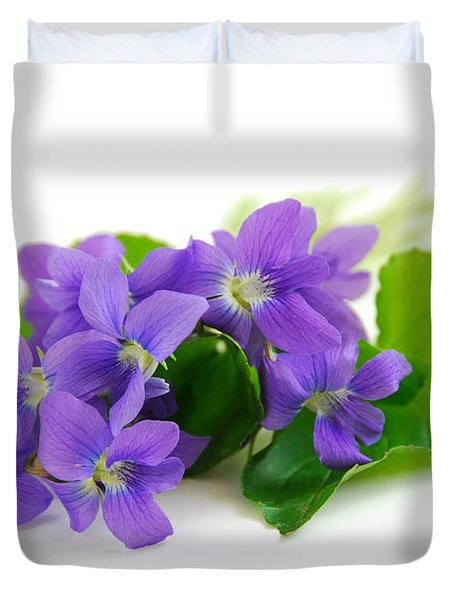 Violets on white background Duvet Cover by Elena Elisseeva