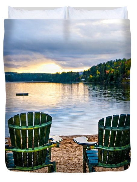 Wooden chairs at sunset on beach Duvet Cover by Elena Elisseeva