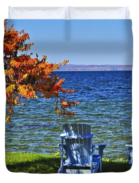 Wooden chairs on autumn lake Duvet Cover by Elena Elisseeva