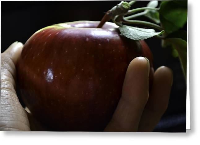 Shades Of Red Greeting Cards -  Apple in Hand Greeting Card by Rae Ann  M Garrett