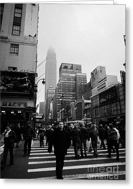 Manhaten Greeting Cards -  Pedestrians Crossing Crosswalk Outside Macys 7th Avenue And 34th Street Entrance New York Winter Greeting Card by Joe Fox