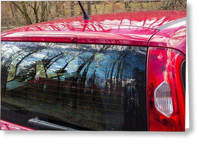 Rear Window Greeting Cards -  Reflection of trees in window of red car Greeting Card by Matthias Hauser