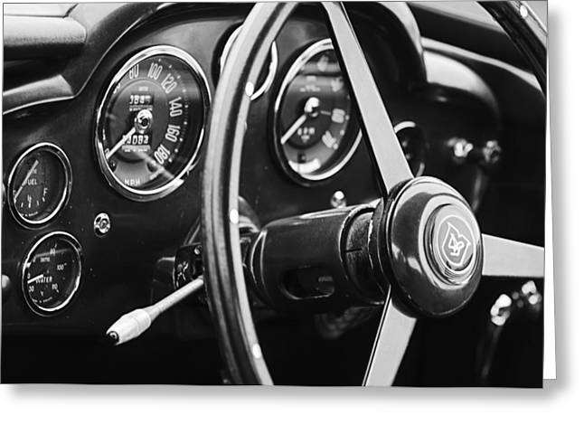 D.w Greeting Cards - 1960 Aston Martin DB4 GT Coupe Steering Wheel Emblem Greeting Card by Jill Reger