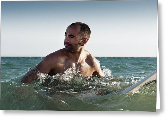 35-39 Years Greeting Cards - A Man With His Surfboard In The Water Greeting Card by Ben Welsh