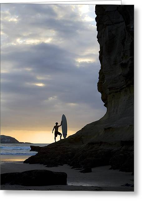 Surf Silhouette Greeting Cards - A Surfer On Muriwai Beach, New Zealand Greeting Card by Deddeda