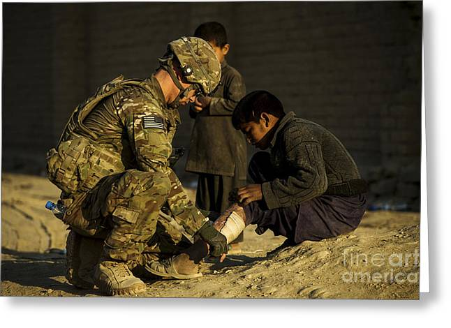 Real People Greeting Cards - Airman Provides Medical Aid To A Local Greeting Card by Stocktrek Images