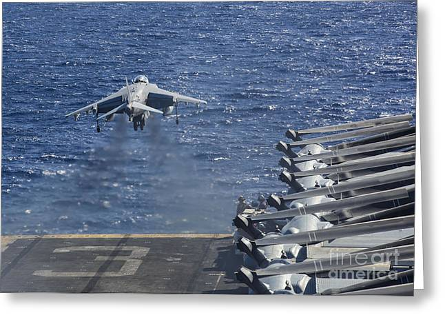 Military Airplanes Greeting Cards - An Av-8b Harrier Takes Greeting Card by Stocktrek Images