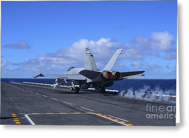 Military Airplanes Greeting Cards - An Fa-18c Hornet Launches From Aircraft Greeting Card by Stocktrek Images