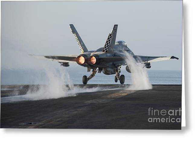 Military Airplanes Greeting Cards - An Fa-18c Hornet Launches From Uss Greeting Card by Stocktrek Images