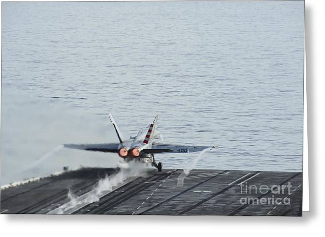 Military Airplanes Greeting Cards - An Fa-18c Hornet Takes Greeting Card by Stocktrek Images