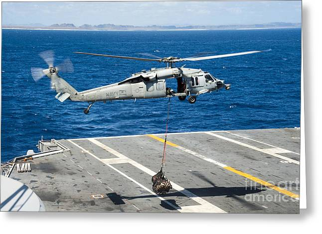 At Arrivals Greeting Cards - An Mh-60s Sea Hawk Delivers Supplies Greeting Card by Stocktrek Images