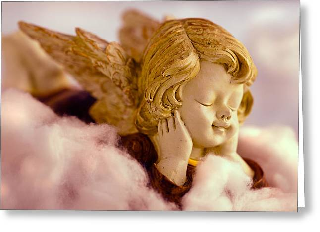 Angel Blues Greeting Cards - Angel resting on clouds and enjoying the sun Greeting Card by Ulrich Schade