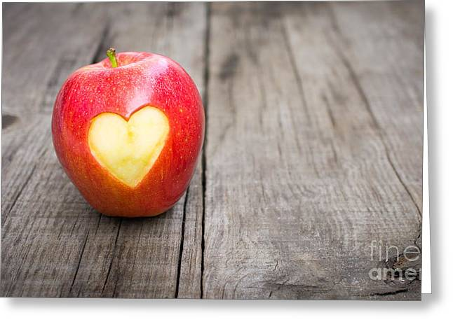 Produce Greeting Cards - Apple with engraved heart Greeting Card by Aged Pixel