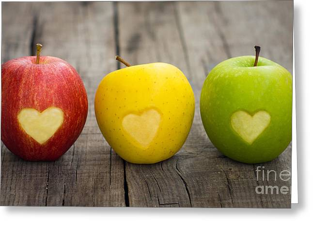 Yellow Apples Greeting Cards - Apples with engraved hearts Greeting Card by Aged Pixel