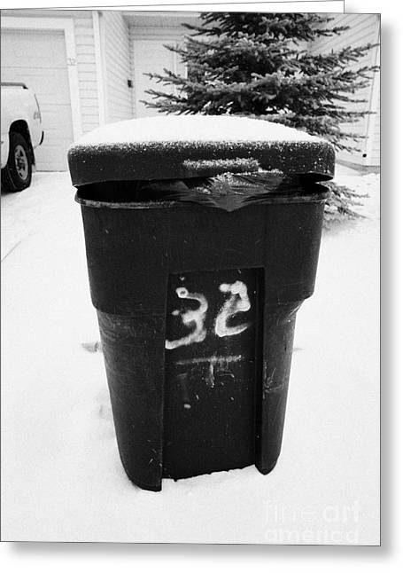 Sticking Out Greeting Cards - bag sticking out of litter waste bin covered in snow outside house in Saskatoon Saskatchewan Canada Greeting Card by Joe Fox