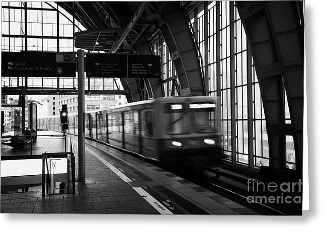 Berlin S-Bahn train speeds past platform at Alexanderplatz main train station Germany Greeting Card by Joe Fox