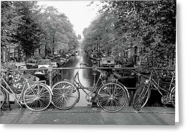 Bicycles On Bridge Over Canal Greeting Card by Panoramic Images