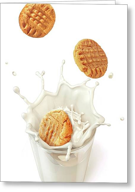 Biscuits Splashing Into Milk Greeting Card by Leonello Calvetti