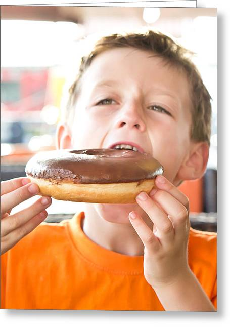 Mischievous Greeting Cards - Boy with donut Greeting Card by Tom Gowanlock