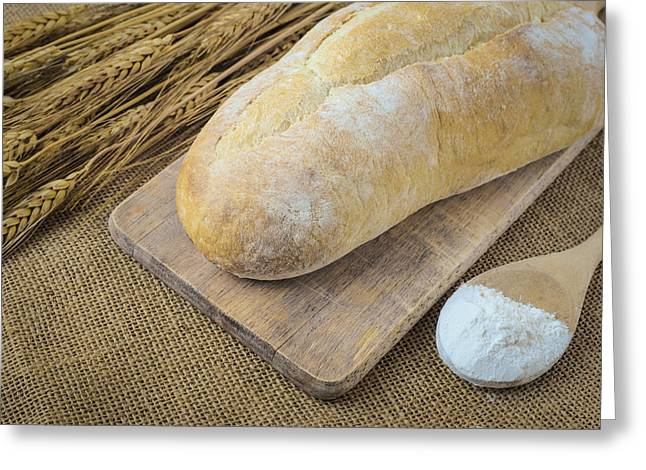 Flour Greeting Cards - Bread on Bread Board with Wheat and Flour filled Spoon on Burlap Greeting Card by Brandon Bourdages