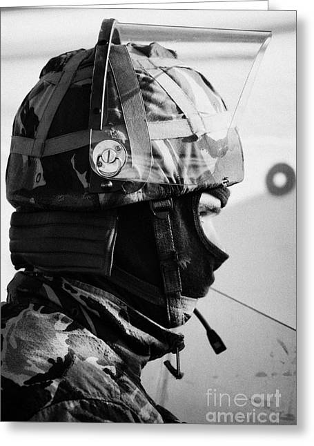 Terrorism Greeting Cards - British Army soldier with helmet and riot gear on crumlin road at ardoyne shops belfast 12th July Greeting Card by Joe Fox