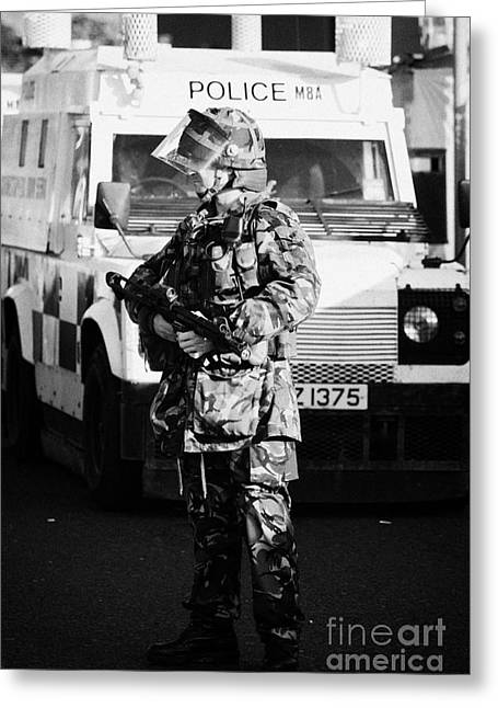 Terrorism Greeting Cards - British Army soldier with MP5 on crumlin road at ardoyne shops belfast 12th July Greeting Card by Joe Fox