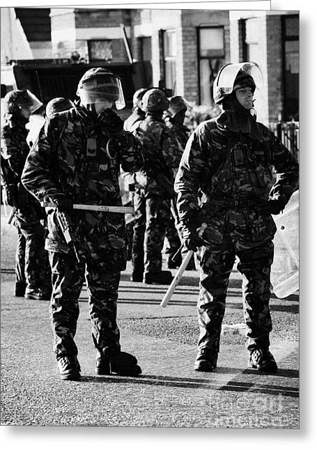 Terrorism Greeting Cards - British Army soldiers in riot gear on crumlin road at ardoyne shops belfast 12th July Greeting Card by Joe Fox
