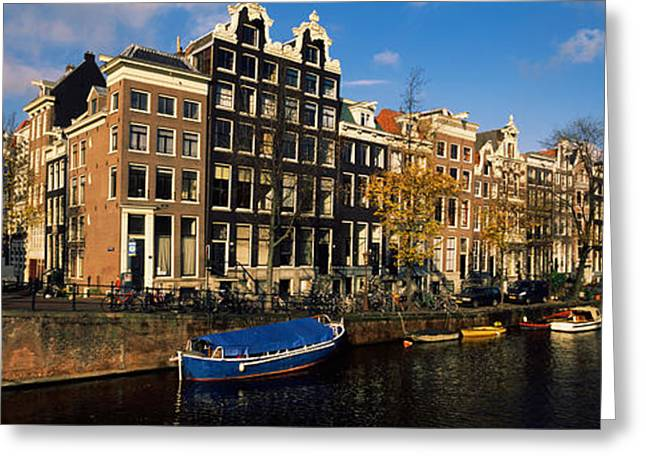 North Holland Greeting Cards - Buildings Along A Canal, Amsterdam Greeting Card by Panoramic Images