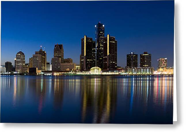 Detroit Photography Greeting Cards - Buildings In A City Lit Up At Dusk Greeting Card by Panoramic Images