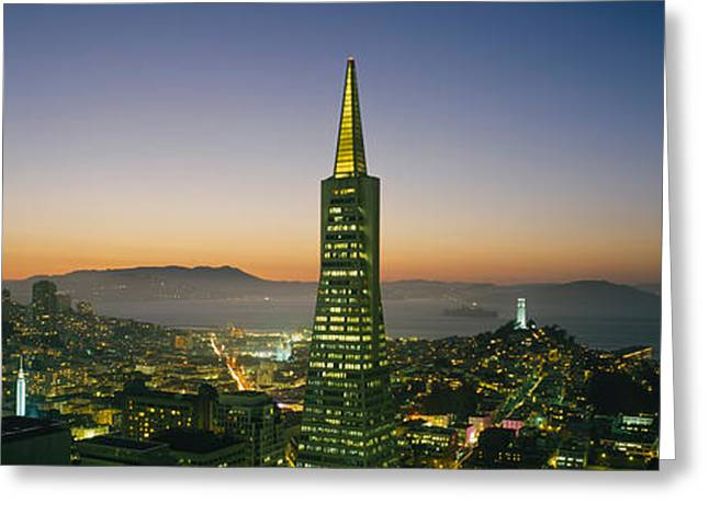 Coit Tower Greeting Cards - Buildings Lit Up At Dusk, Transamerica Greeting Card by Panoramic Images