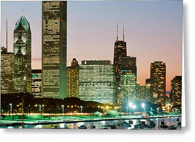 20th Greeting Cards - Buildings Lit Up At Night, Chicago Greeting Card by Panoramic Images