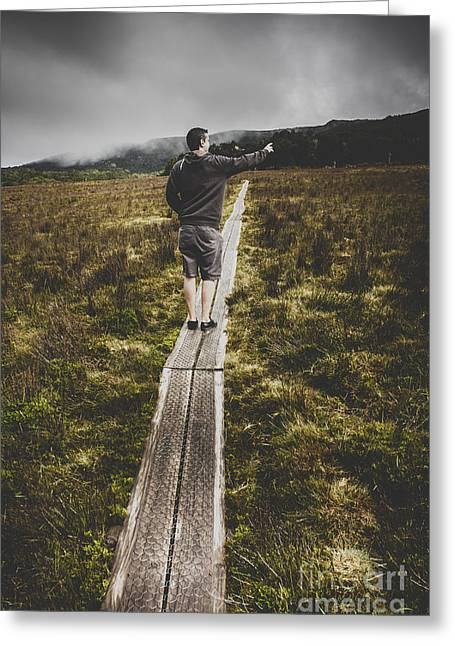 Cradle-mountain Greeting Cards - Bushwalking man in stormy remote mountain range Greeting Card by Ryan Jorgensen