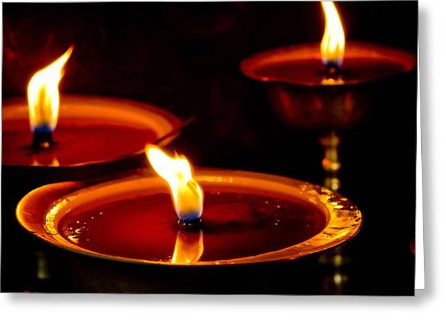 Milarepa Greeting Cards - candle light in Boudnath stupa Greeting Card by Raimond Klavins