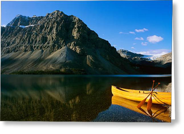 Canoe Photographs Greeting Cards - Canoe At The Lakeside, Bow Lake, Banff Greeting Card by Panoramic Images