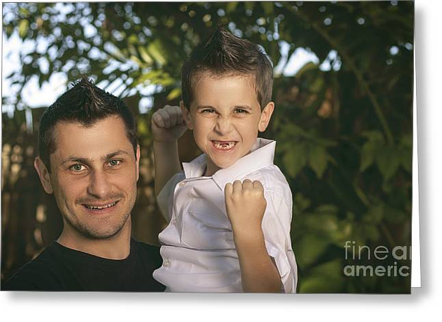 Happy Man Greeting Cards - Cheering child and man bonding on fathers day Greeting Card by Ryan Jorgensen