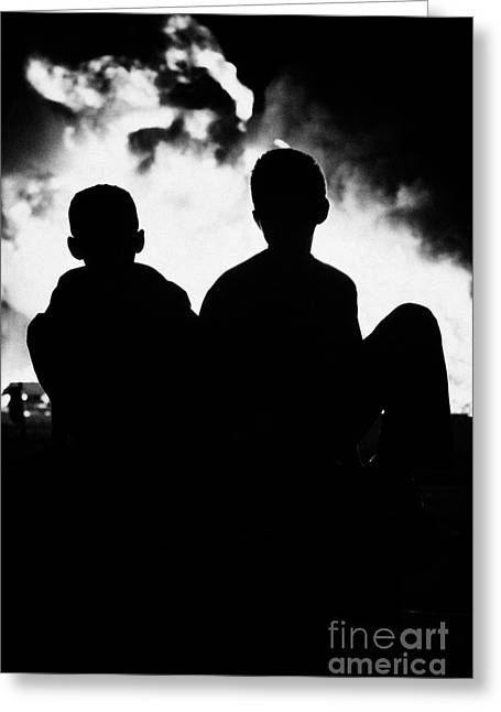 Protest Greeting Cards - children sitting watching 11th night bonfire in Monkstown Greeting Card by Joe Fox