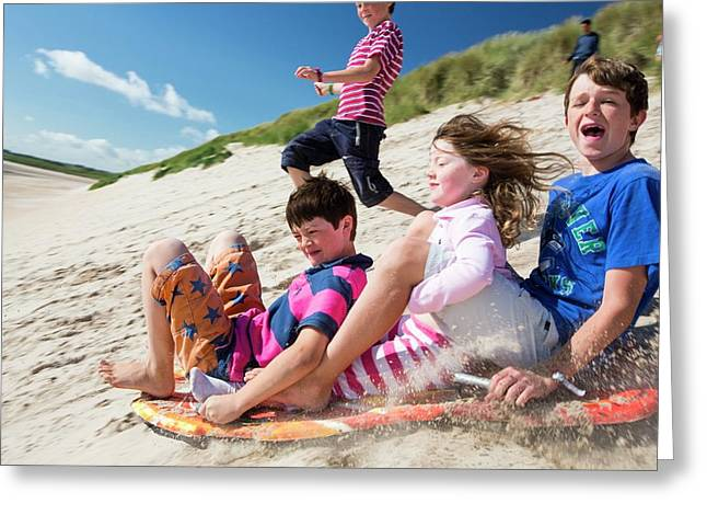 Children Using Body Boards Greeting Card by Ashley Cooper