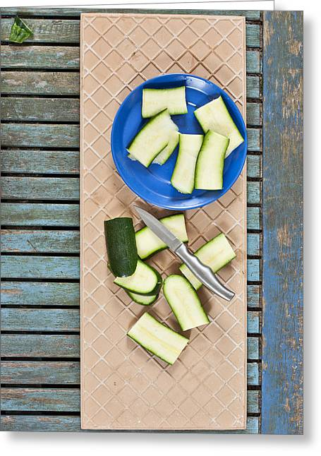 Background Greeting Cards - Chopped courgette Greeting Card by Tom Gowanlock