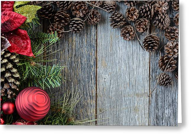 Pine Cones Greeting Cards - Christmas Decorations with Pine Cones and Rustic Wood Background Greeting Card by Brandon Bourdages