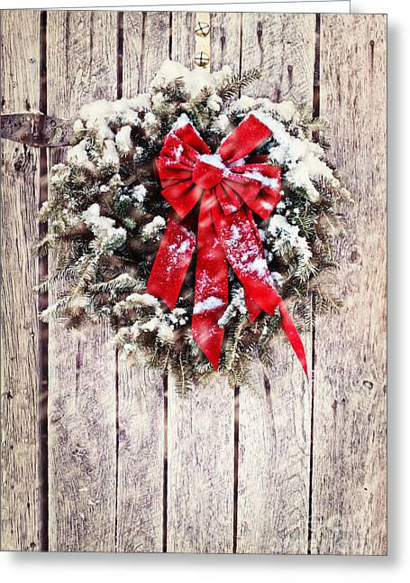 Snowy Night Night Greeting Cards - Christmas Wreath on Barn Door Greeting Card by Stephanie Frey