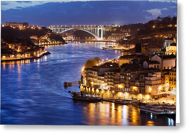 City Of Porto By Douro River At Night In Portugal Greeting Card by Artur Bogacki