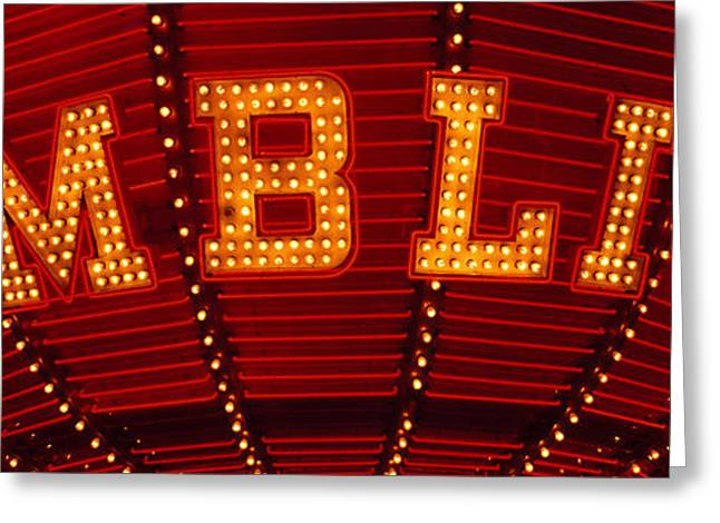 Commercial Photography Greeting Cards - Close-up Of A Neon Sign Of Gambling Greeting Card by Panoramic Images