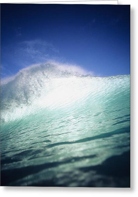 Blue Green Wave Greeting Cards - Closeup angle of green wave with backlit crest, bright blue sky Greeting Card by Vince Cavataio