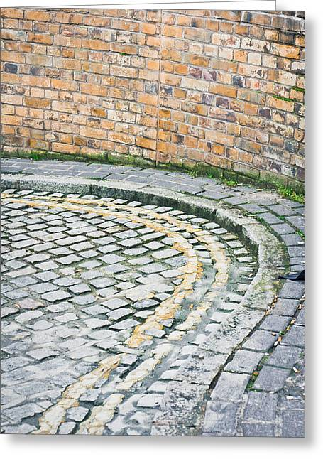 Kerb Greeting Cards - Cobbled street Greeting Card by Tom Gowanlock
