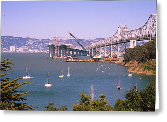 Sailboat Images Greeting Cards - Cranes At A Bridge Construction Site Greeting Card by Panoramic Images