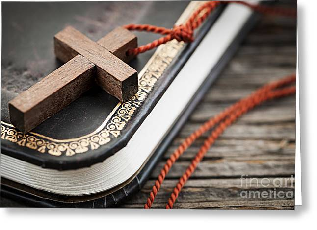 Cross On Bible Greeting Card by Elena Elisseeva